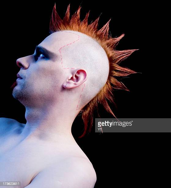 Punk male with mohawk hairstyle on black background