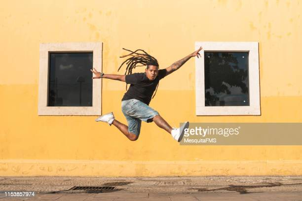 punk person jumping on the street - punk person stock pictures, royalty-free photos & images