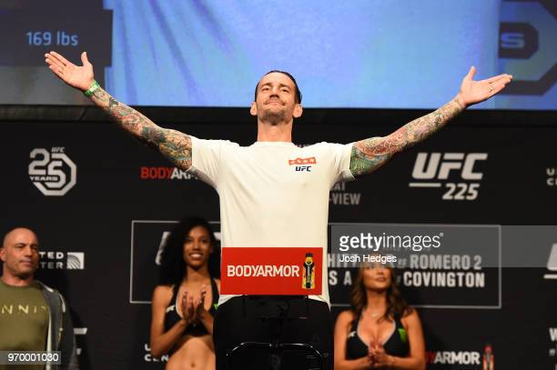 Punk poses on the scale during the UFC 225 weighin at the United Center on June 8 2018 in Chicago Illinois