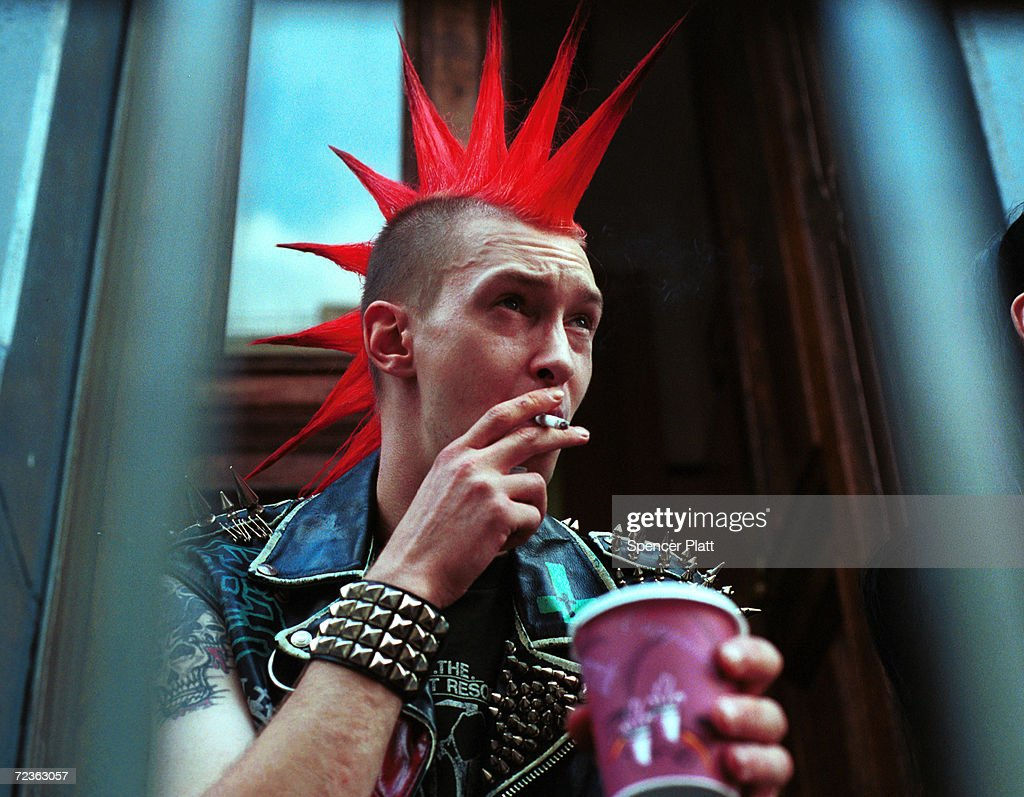 A punk rock enthusiast hangs out on Saint Marks Street September 5, 2000 in the East Village in New York City. Saint Marks is one of the last areas in the city where eccentrics, artists, tourists and the dispossessed all converge.