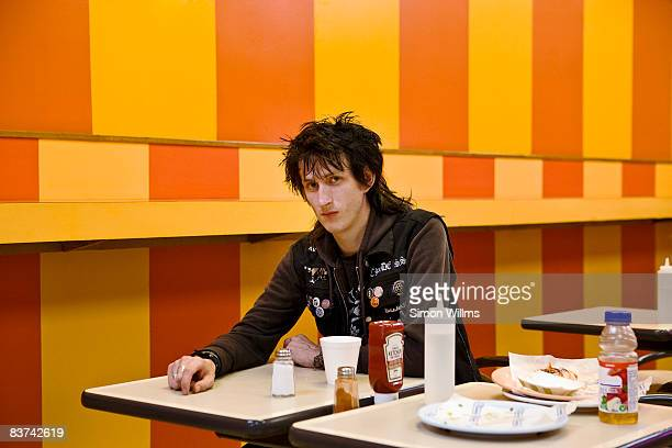 Punk rock guy sitting in dinner