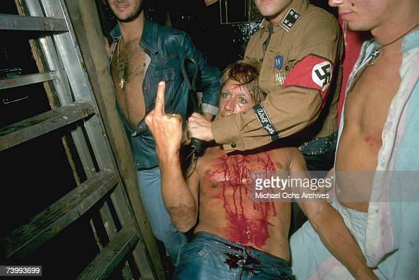 Punk rocker Iggy Pop performs an improvised play called 'Murder of the Virgin' at Rodney Bingenheimer's English Disco on August 111974 in Los Angeles...