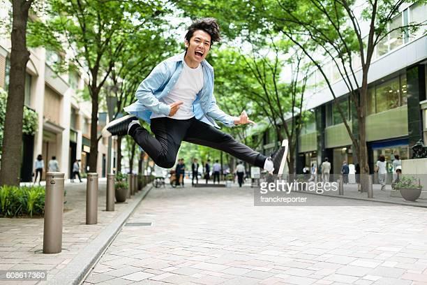 punk rocker jumping in tokyo - 大人のみ ストックフォトと画像