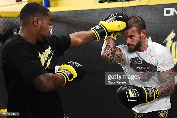 Punk spars with Mike Biggie Rhodes during a training session at Roufusport Martial Arts Academy on August 29 2016 in Milwaukee Wisconsin