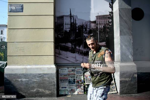 A punk walks in Omonoia square in Athens Greece May 4 2017