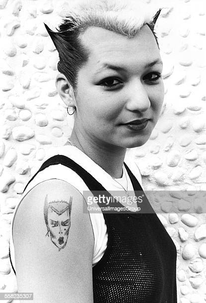 A punk with a Soo Catwoman tattoo on her shoulder UK 1980