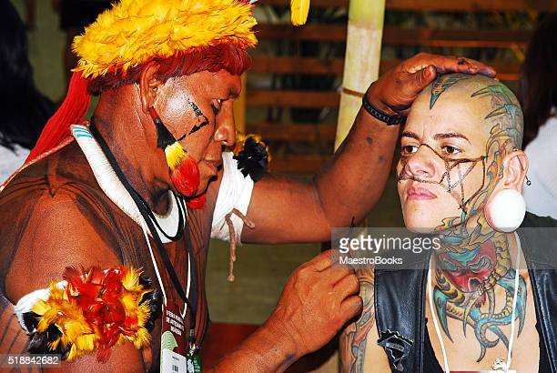 Punk woman having her face painted