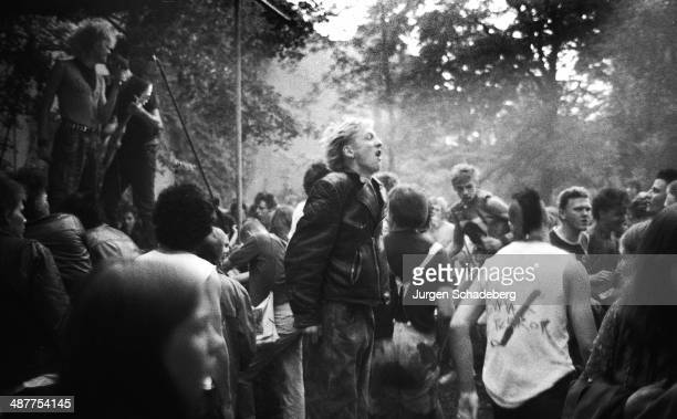 Punks attend a concert in the grounds of an Evangelist church in East Berlin Germany 1982