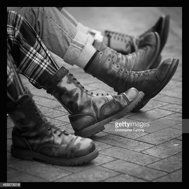 Punks show off the Doctor Marten boots as they gather in Blackpool for the annual Rebellion Punk Rock Festival on August 8 2014 in Blackpool England...
