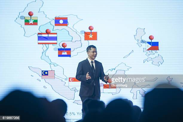 Punnamas Vichitkulwongsa chief executive officer of Ascend Group Co Ltd gestures as he speaks during a news conference in Hong Kong China on Tuesday...