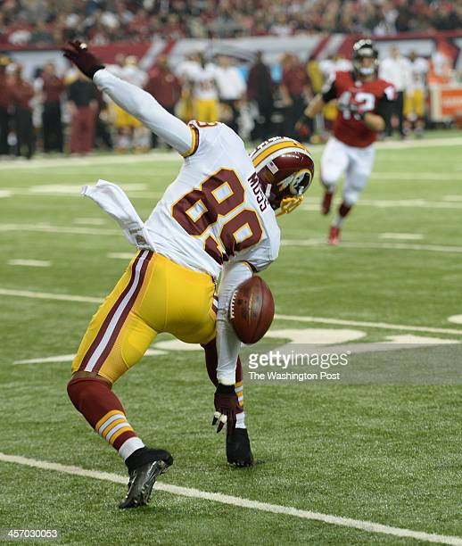 A punt bounces off the back of Washington Redskins wide receiver Santana Moss that was recovered by Atlanta Falcons cornerback Robert McClain during...