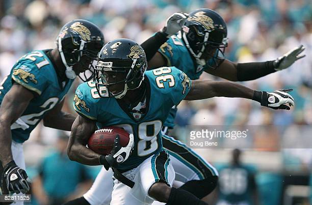 Punt returner Brian Witherspoon of the Jacksonville Jaguars looks for room to run while taking on the Buffalo Bills at Jacksonville Municipal Stadium...