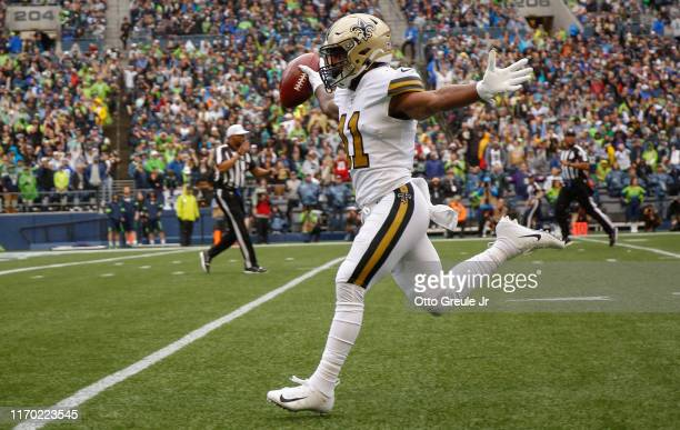 Punt returner Deonte Harris of the New Orleans Saints rushes for a touchdown in the first quarter against the Seattle Seahawks at CenturyLink Field...