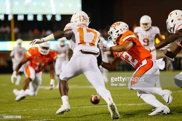 A punt slips through the hands of D'Shawn Jamison of the Texas Longhorns for a fumble recovered by his teammate Collin Johnson against cornerback...