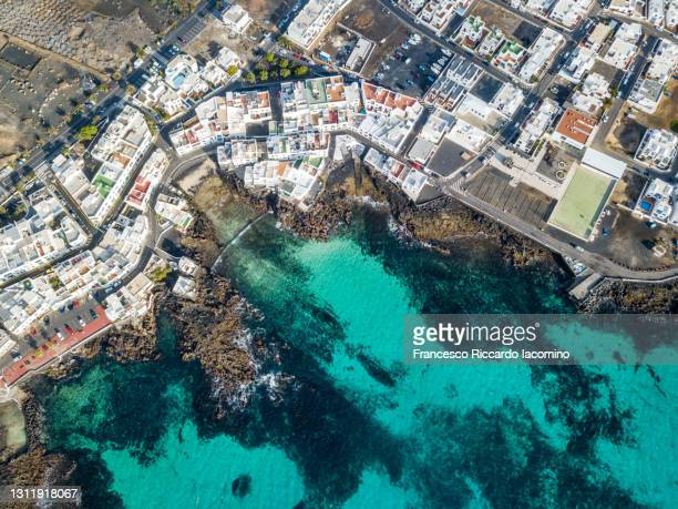 punta mujeres, town in lanzarote north east coast, canary islands. aerial view - francesco riccardo iacomino spain foto e immagini stock