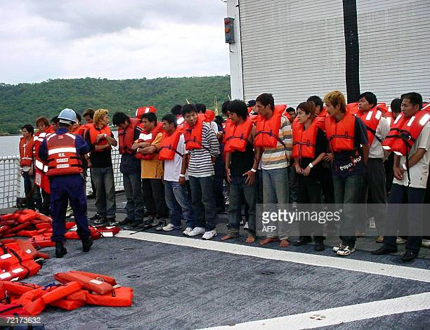 Costo Rican and US migratory authorities take care 14 October 2006 in Puntarenas Costa Rica of 70 Chinese and 58 Peruvians that were found adrift in...
