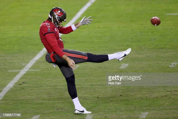Punter Bradley Pinion of the Tampa Bay Buccaneers kicks the ball in the second half of the NFC Wild Card playoff game against the Washington Football...