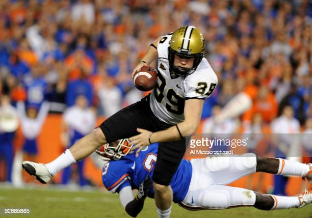 Punter Brett Upson of the Vanderbilt Commodores dodges a tackle after a bad snap against the Florida Gators November 7, 2009 at Ben Hill Griffin...
