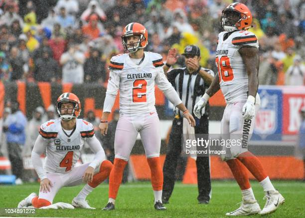 Punter Britton Colquitt kicker Zane Gonzalez and tight end Darren Fells of the Cleveland Browns watch after a blocked field goal in overtime of a...