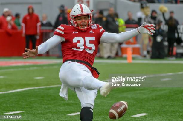 Punter Caleb Lightbourn of the Nebraska Cornhuskers slips on a punt attempt against the Purdue Boilermakers at Memorial Stadium on September 29 2018...
