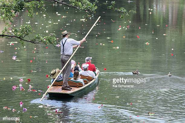 A punter comes along with tourists after members of the public released flowers into the Avon River as remembrance following a Civic Memorial Service...