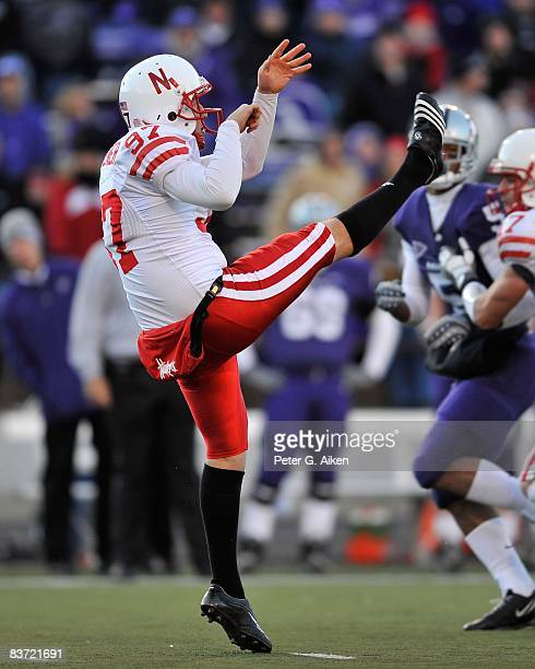 Punter Dan Titchener of the Nebraska Cornhuskers punts the ball down field against the Kansas State Wildcats during the third quarter on November 15...