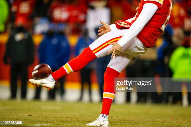 Punter Dustin Colquitt of the Kansas City Chiefs kicks the football in the third quarter during the AFC Championship Game against the New England...