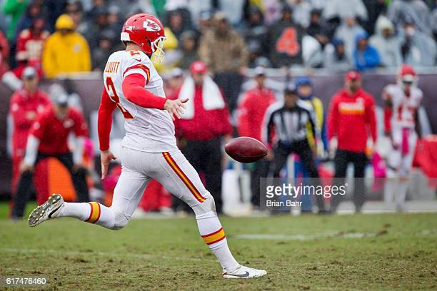 Punter Dustin Colquitt of the Kansas City Chiefs launches the ball 46 yards to the 20 yard line against the Oakland Raiders late in the fourth...