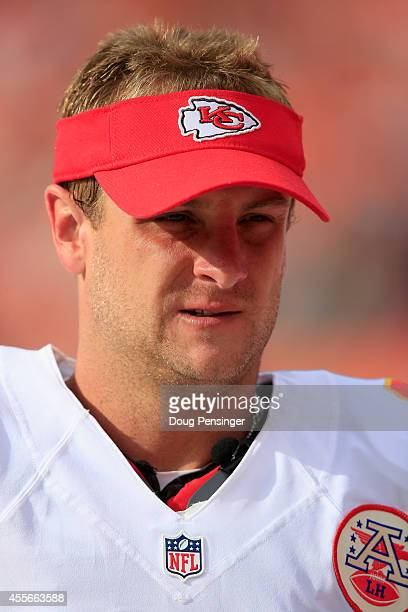 Punter Dustin Colquitt of the Kansas City Chiefs looks on from the bench against the Denver Broncos at Sports Authority Field at Mile High on...