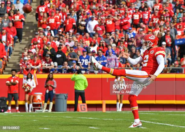 Punter Dustin Colquitt of the Kansas City Chiefs punts the ball down field against the Buffalo Bills during the first half at Arrowhead Stadium on...