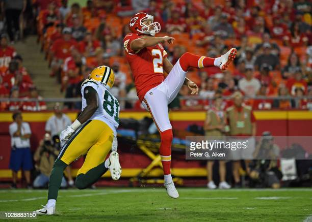 Punter Dustin Colquitt of the Kansas City Chiefs punts the ball during the first half against the Green Bay Packers on August 30 2018 at Arrowhead...