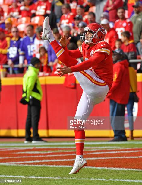 Punter Dustin Colquitt of the Kansas City Chiefs punts the ball during pregame prior to a game against the Minnesota Vikings at Arrowhead Stadium on...