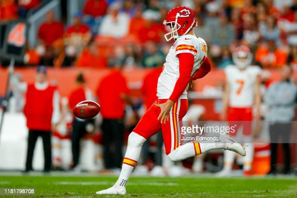 Punter Dustin Colquitt of the Kansas City Chiefs punts the football against the Denver Broncos during the second quarter at Empower Field at Mile...