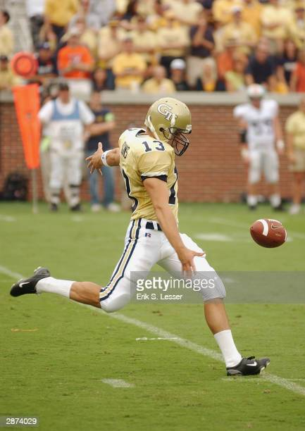 Punter Hal Higgins of the Georgia Tech Yellow Jackets punts the ball during the game against the Auburn Tigers on September 6 2003 at Bobby Dodd...