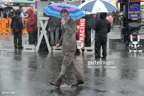 A punter in a rain drenched suit during day four of the 2013 Galway Summer Festival at Galway Racecourse Ballybrit Ireland