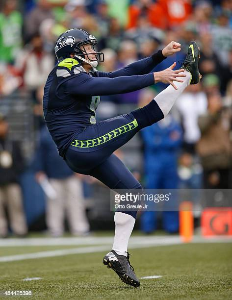 Punter Jon Ryan of the Denver Broncos punts against the Seattle Seahawks at CenturyLink Field on August 14 2015 in Seattle Washington