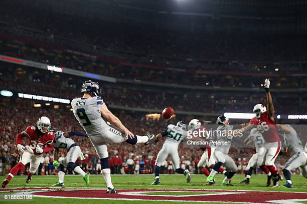 Punter Jon Ryan of the Seattle Seahawks punts the football during the NFL game against the Arizona Cardinals at the University of Phoenix Stadium on...