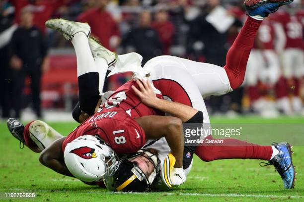 Punter Jordan Berry of the Pittsburgh Steelers is tackled by tight end Darrell Daniels of the Arizona Cardinals in the second half of the NFL game at...
