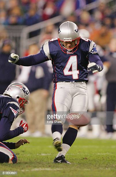 Punter Josh Miller of the New England Patriots holds the ball for kicker Adam Vinatieri during the game against the Buffalo Bills at Gillette Stadium...