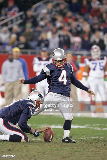 Punter Josh Miller of the New England Patriots holds the ball so kicker Adam Vinatieri can attempt to score during the game against the Buffalo Bills...