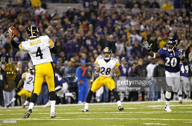Punter Josh Miller of the Pittsburgh Steelers passes to Chris Hope on a faked punt on fourth down as Hope eluded Ed Reed and the Baltimore Ravens and...