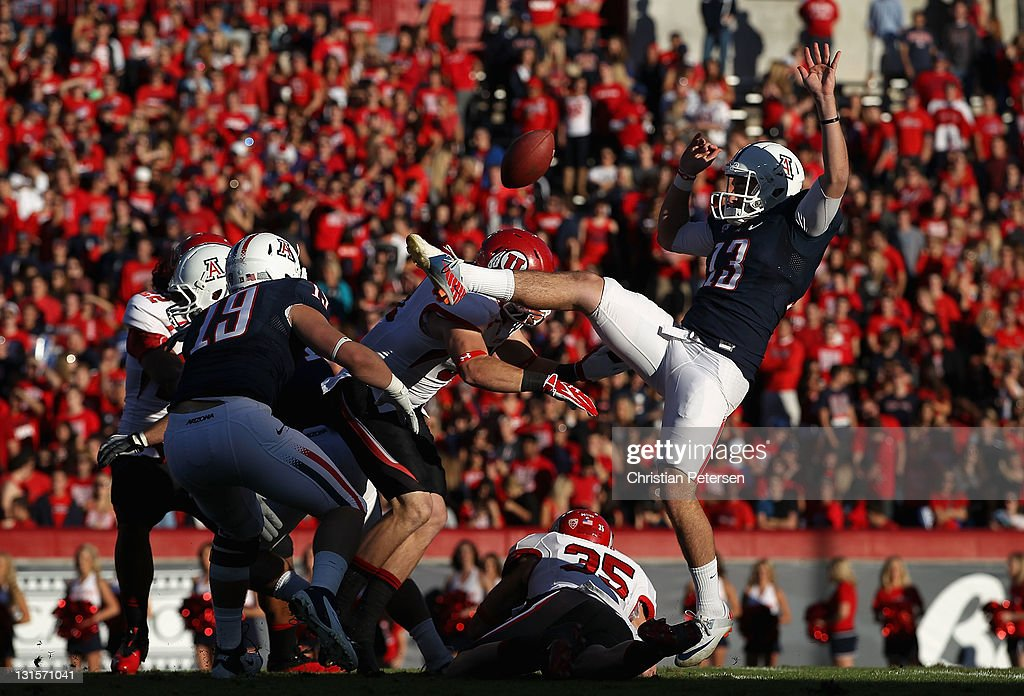 Punter Kyle Dugandzic #13 of the Arizona Wildcats has his kick blocked by the Utah Utes during the first quarter of the college football game at Arizona Stadium on November 5, 2011 in Tucson, Arizona. The Utes defeated the Wildcats 34-21.