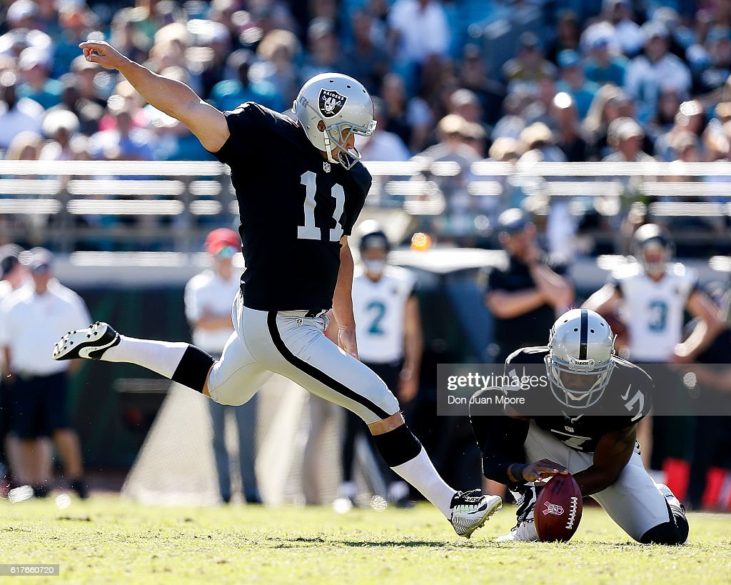 Punter Marquette King #7 holds the ball for Kicker Sebastian Janikowski #11 of the Oakland Raiders during the game against the Jacksonville Jaguars at EverBank Field on October 23, 2016 in Jacksonville, Florida. The Raiders defeated the Jaguars 33 to 16.