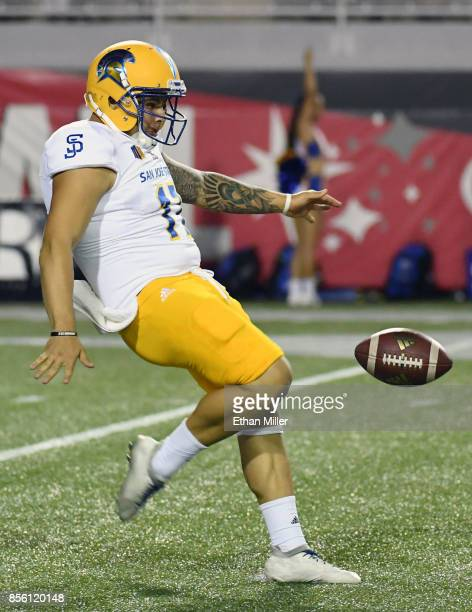 Punter Michael Carrizosa of the San Jose State Spartans punts a ball that was blocked during a game against the UNLV Rebels at Sam Boyd Stadium on...