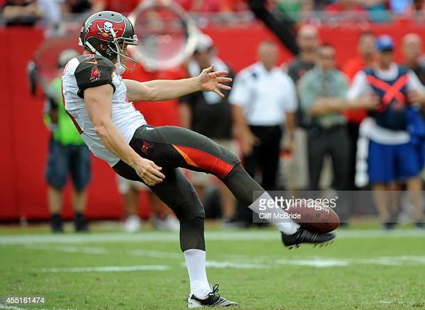 Punter Michael Koenen of the Tampa Bay Buccaneers punts the ball against Carolina Panthers at Raymond James Stadium on September 7 2014 in Tampa...