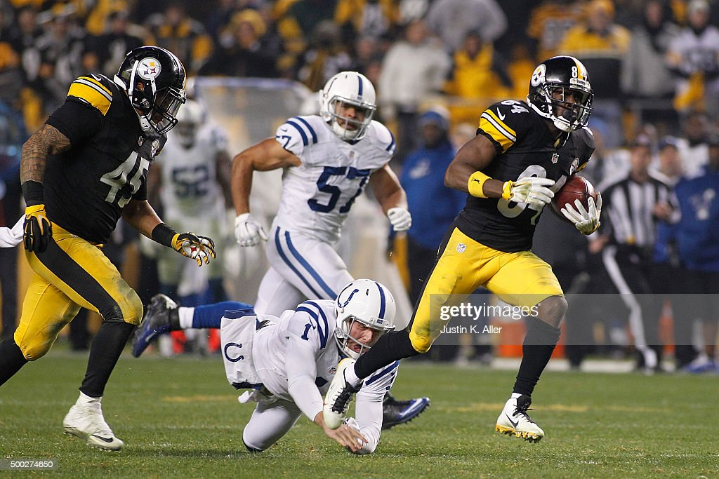 Punter Pat McAfee #1 of the Indianapolis Colts attempts to tackle Antonio Brown #84 of the Pittsburgh Steelers as he returns a punt for a 71 yard touchdown in the fourth quarter of the game at Heinz Field on December 6, 2015 in Pittsburgh, Pennsylvania.
