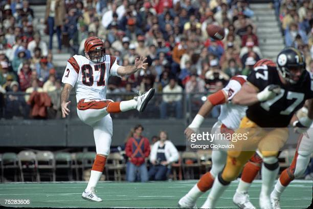 Punter Pat McInally of the Cincinnati Bengals punts against the Pittsburgh Steelers at Riverfront Stadium circa 1980 in Cincinnati Ohio
