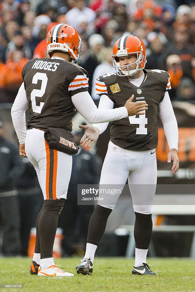 Punter Reggie Hodges #2 of the Cleveland Browns celebrates with teammate kicker Phil Dawson #4 after Dawson kicked the go-ahead field goal during the second half against the Baltimore Ravens at Cleveland Browns Stadium on November 4, 2012 in Cleveland, Ohio. The Ravens defeated the Browns 25-15.