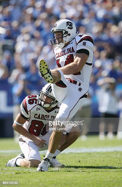 Punter Ryan Succop of the South Carolina Gamecocks kicks as teammate Stephen Flint looks on against the Kentucky Wildcats during the game at...