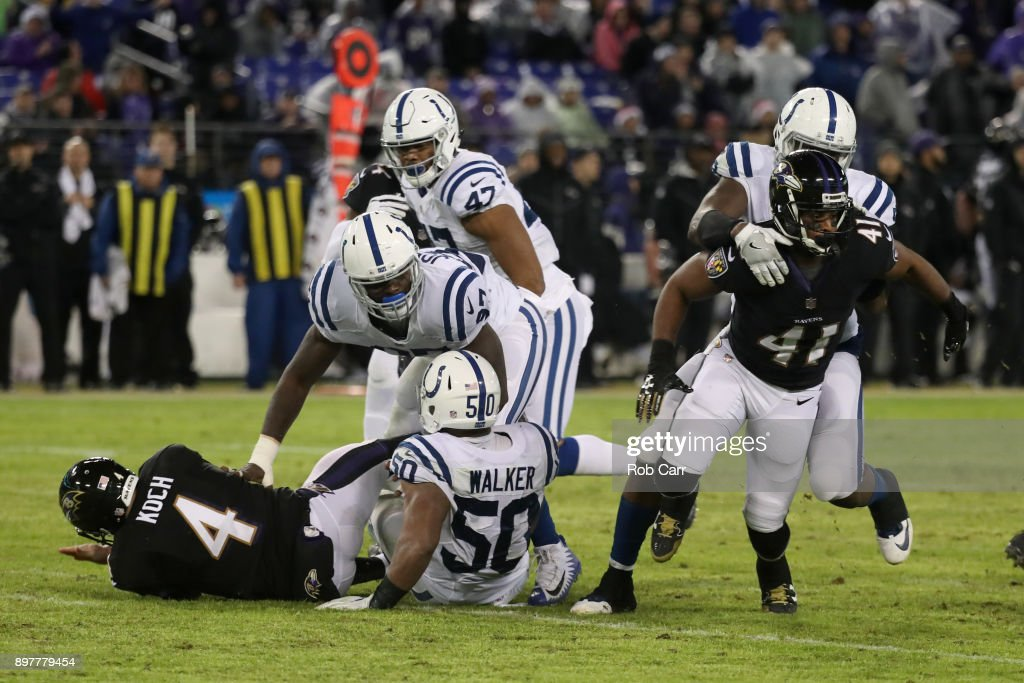 Punter Sam Koch #4 of the Baltimore Ravens is knocked down during a blocked punt in the fourth quarter against the Indianapolis Colts at M&T Bank Stadium on December 23, 2017 in Baltimore, Maryland.